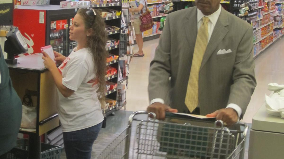 Congressman Cleaver shops for groceries with a local resident on minimum wage.